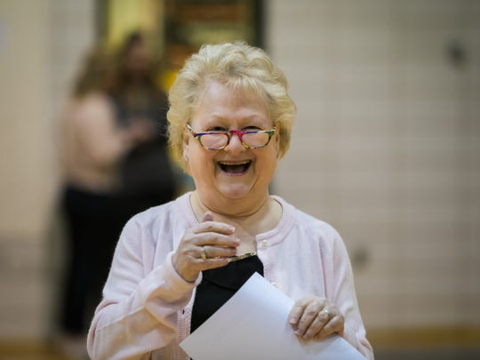 Cindy Mann returns to Padua Academy with a smile as she addresses her students who gathered in the gym on her firing along with love and forgiveness.