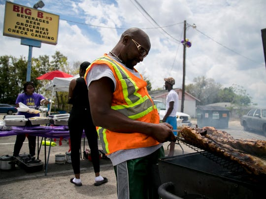Esther's Carey's uncle Charlie Fowler came out to smoke ribs to add an extra option for her food stand at Big B near the corner of Veronica Shoemaker Boulevard and Michigan Avenue in Fort Myers.
