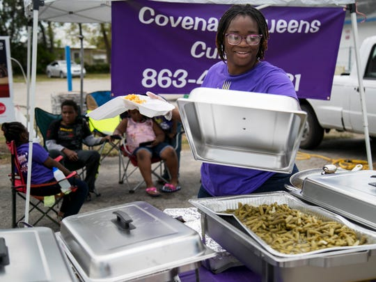 Esther Carey makes a plate on the opening day of her food stand on Saturday, April 21, 2018, at Big B near the corner of Veronica Shoemaker Boulevard and Michigan Avenue in Fort Myers.