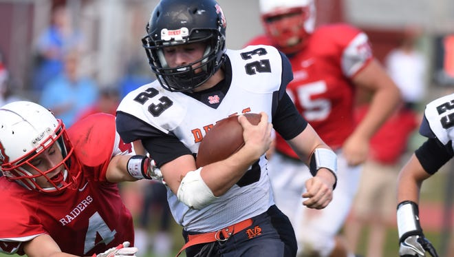 Marlboro's Phil DeSantis carries the ball in the Iron Dukes' 50-20 win over Red Hook on Sept. 24. He scored three touchdowns on 240 yards against the Raiders.