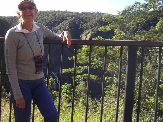 Yvonne enjoys a photo stop along the Kuranda Scenic Railway.