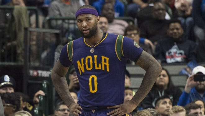 New Orleans Pelicans forward DeMarcus Cousins (0) talks with Pelicans head coach Alvin Gentry after Cousins committed a foul during the second quarter against the Dallas Mavericks.