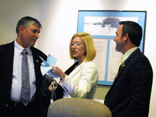 Rentschler talks to Susie Galea and Jason Baldwin in 2013 after he was selected as mayor.
