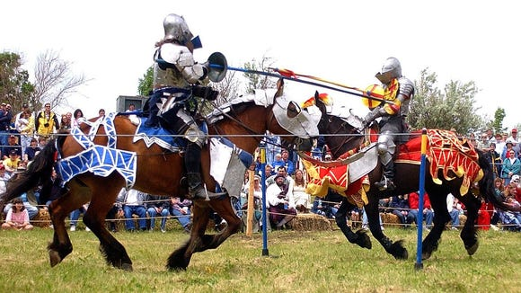 Kevin Coble, left, and Dave Schade, New Riders of the Golden Age, connect in full contact jousting at the festival, the ten feet, two inch poles crashing into each other and shattering on impact as they try to dismount one another. (Lloyd B. Cunningham/Argus Leader) 7 June 2003