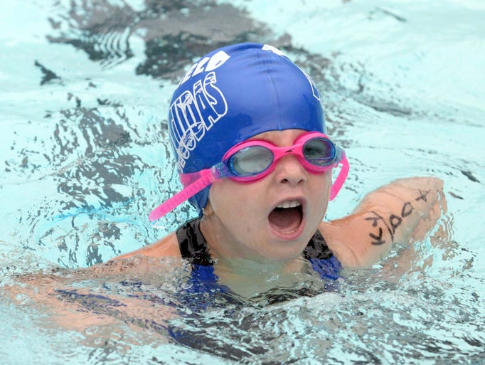 Newfield's Kyleigh Dotzel competes in a medley relay during Olympic Swim Meet 2014 at the Northwest Swim Club in Vineland on Saturday, August 14, 2014.  Staff photo/Charles J. Olson