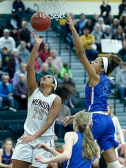 Pittsford Mendon's Lexi Green sends the ball to the