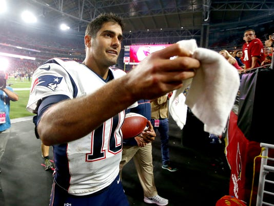 New England Patriots quarterback Jimmy Garoppolo (10) leaves the field after an NFL football game against the Arizona Cardinals, Sunday, Sept. 11, 2016, in Glendale, Ariz. The Patriots won 23-21. (AP Photo/Ross D. Franklin)