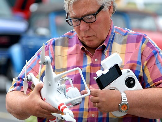 Jim Rutt prepares to pilote by remote control a drone outside Staunton Makerspace, which he co-founded, in Staunton on Tuesday, June 3, 2014. The drone is one of the tools that will be available for use by members.