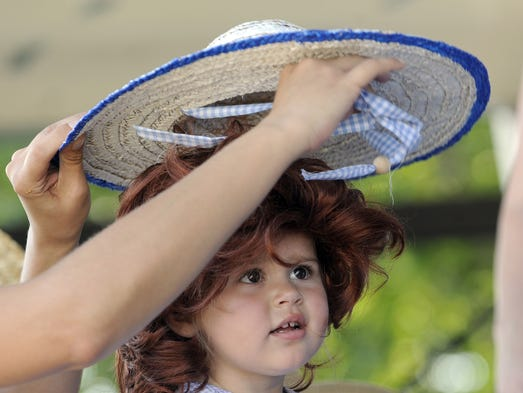 Genesis Grandstaff, 2, of Stuarts Draft has her hat and wig adjusted while competing in the 5 and under Little Debbie look-alike-contest during the Sweet Dreams Day 2010 in Stuarts Draft on Saturday, July 24, 2010.