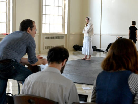 In character, Maeve Edwards as Lady Grey stands with arms folded as a scene unfolds during a rehearsal of Henry VI, Part 3. It is part of American Shakespeare Company's 3-week-long theater camp on the campus of Mary Baldwin College on Thursday, August 7, 2014. Actor Will Norton stands in character nearby.
