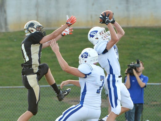 Fort Defiance's Colton Lackey intercepts a pass intended for Buffalo Gap's Trevor Chittum as Fort's Trenton Campbell is ready to assist. Fort Defiance High School faced off against Buffalo Gap High School during a football game played in Swoope on Friday, August 29, 2014