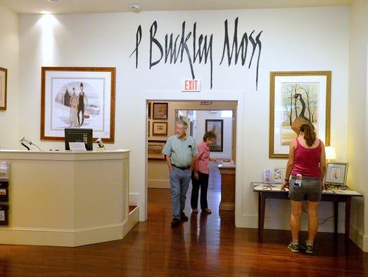 People look around inside the P. Buckley Moss Waynesboro Gallery located on West Main Street in downtown Waynesoro on Wednesday, Sept. 3, 2014.