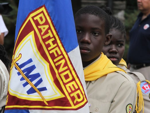 The Pathfinder Camporee participants from all around the country and overseas paraded through the streets of Oshkosh Saturday displaying their purpose to those who watched them march by.