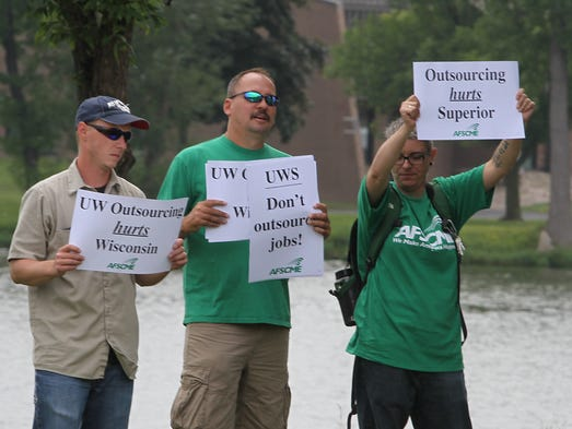 The American Federation of State, County and Municipal Employees (AFSCME) hold a rally at Carl Steiger Park  near the new University Alumni building in Oshkosh to show support to union workers in Superior where jobs are being threatened by outsourcing.