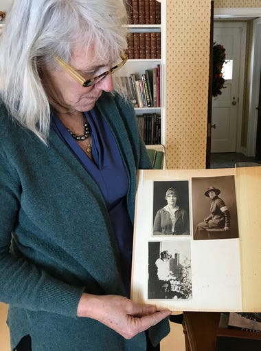 Elizabeth Goessling looks at photos of her grandmother, Hildegarde Van Brunt Abbott, who served as a telephone operator in France during World War I with the U.S. Army Signal Corps.