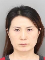 A mugshot of Cuimin Zhang.