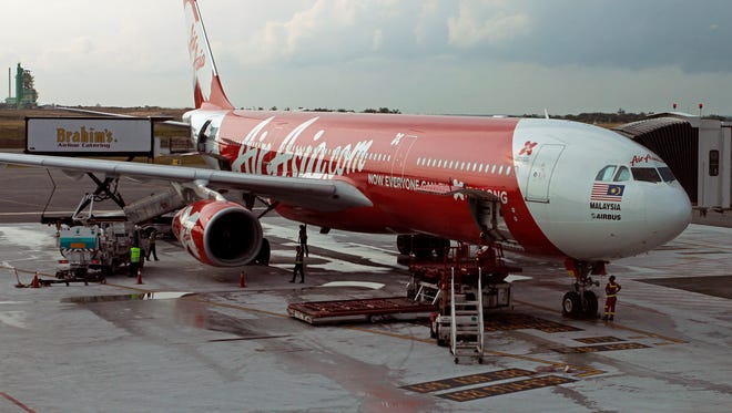 This Nov. 10 photo shows an AirAsia A320-200 passenger jet, the kind of aircraft that was reported missing Dec. 28.