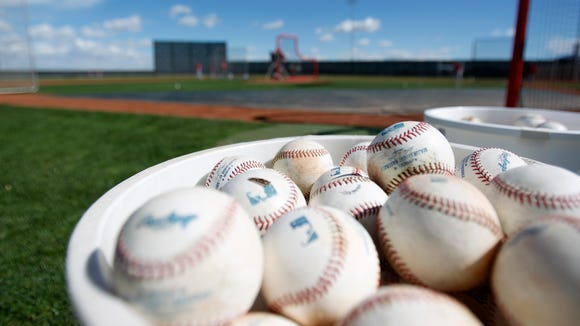 A bucket balls sit as position players take batting practice at Spring Training Tuesday, Feb. 24 in Goodyear, Arizona.