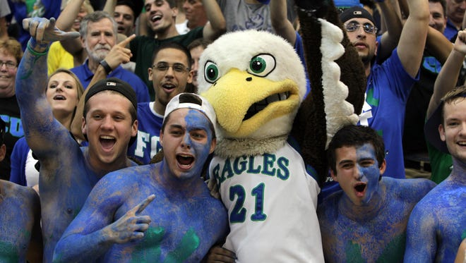 Kristian Avellanet, Nick Schilson, Azul the FGCU Eagle mascot, Nick Mucerino and Dario Nachef celebrate the Eagle's trip to the Sweet 16 during a pep rally Monday at Alico Arena.