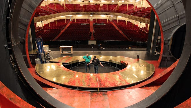 Master carpenter Rob Lay (left) and technical director Gary Kidney work on the set of the Cincinnati Opera's production of  Turandot at Music Hall.