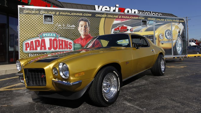 The gold and black Chevrolet Camaro (shown here in 2011) owned by Papa John's founder John Schnatter was stolen recently from a classic car show.