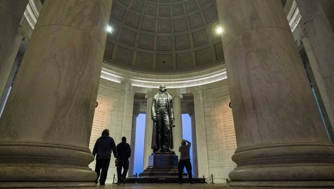 People visit the Thomas Jefferson Memorial on April 12, 2014, in Washington, D.C.