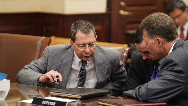 Peter Beck with attorneys at sentencing Thursday morning.
