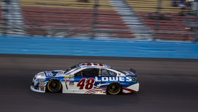 Lowe's Patriotic Chevrolet's Jimmie Johnson drives during the NASCAR Sprint Cup qualifying race on Friday, Nov. 13, 2015 at Phoenix International Raceway in Avondale, AZ.