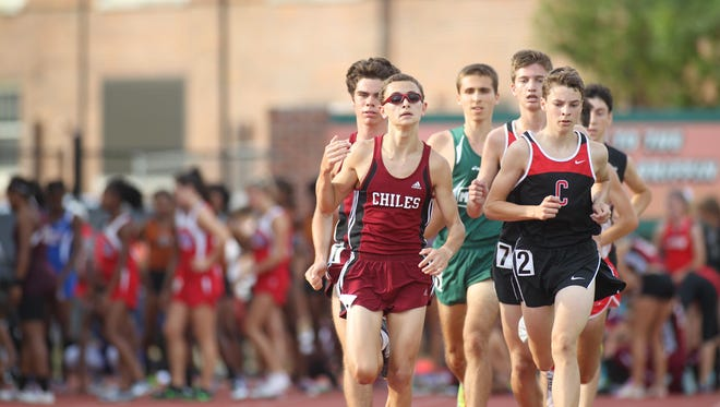 Chiles' Matthew Newland heads the lead pack during the 3200 in Thursday's Region 1-3A meet. Newland won, his first victory ever, helping the Timberwolves win a regional title.