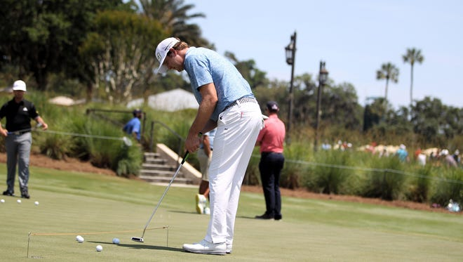 Maclay alum and PGA Tour pro Hudson Swafford practices on a putting green at TPC Sawgrass as preparation for his tournament debut at THE PLAYERS Championship. Swafford opened his tournament Thursday with a 6-under par 66, good for a tie for seventh.