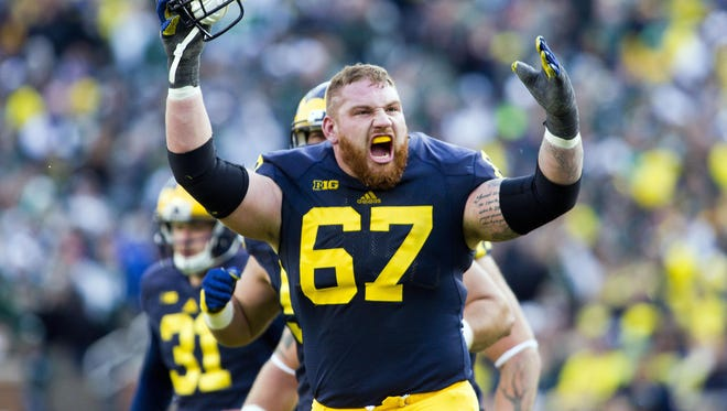 Michigan offensive lineman Kyle Kalis celebrates a ruling confirming a Michigan touchdown after it was reviewed, in the third quarter of a game against Michigan State in Ann Arbor on Oct. 17, 2015.