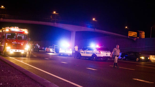 Emergency personnel work a scene at State Route 51 and Thomas Road in Phoenix on Sept. 7, 2016. A woman was shot in the head earlier in the evening going northbound on the 51.