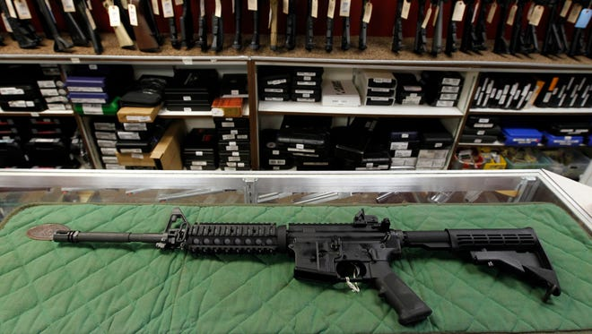 An AR-15 is displayed at the Firing-Line indoor range and gun shop July 26, 2012 in Aurora, Colo.