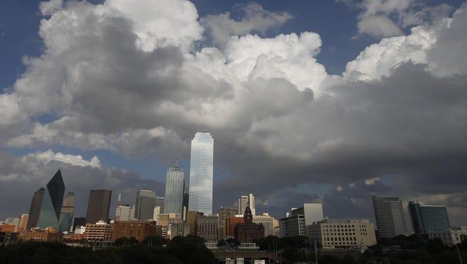 Clouds surround the Dallas skyline.