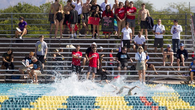 Chaparral fans and swimmers cheer on their school during the Division II state swimming and diving championships at the Skyline Aquatic Center in Mesa on Saturday, Nov. 5, 2016.