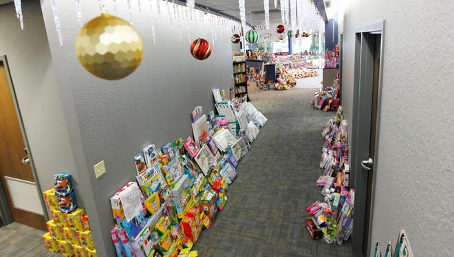 Hundreds of donated toys line the halls at KAPCO. The metal fabricating and stamping business will be collecting as many as 20,000 toys for its 11th Annual Kids2Kids Christmas at Kapco Toy Drive.