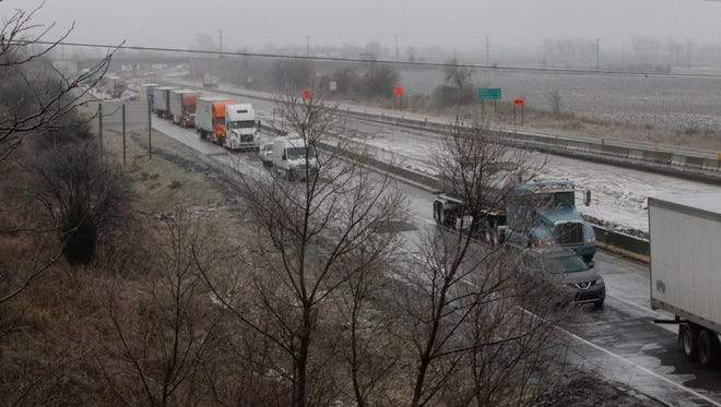 Stranded motorists on northbound I-65 had nothing to do Friday night and Saturday morning but wait. Ice closed the highway between Indiana 38 and Indiana 43. Police worked to get everyone off the highway so INDOT could salt the highway.