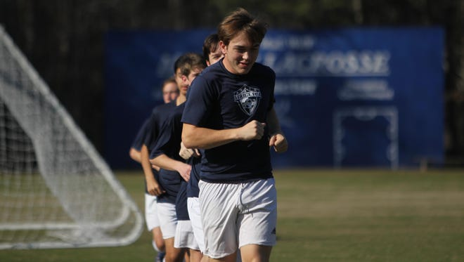 Senior captain Lucas Briggs and the Maclay boys soccer team warm up at practice on Monday in anticipation for Thurday's FHSAA Class 1A state championship game in DeLand.
