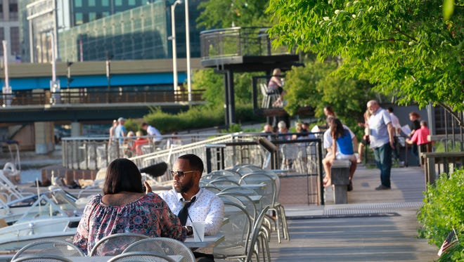 Customers dine along the Riverwalk  in the Historic Third Ward on June 15, 2017.