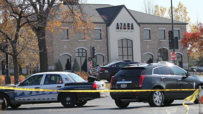 Police mark off the scene at Azana Salon & Spa in Brookfield after a man shot several people before taking his own life on Oct. 21, 2012.