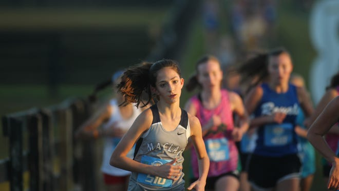 Maclay seventh-grader Ella Porcher races during her regional cross country meet at Oaks Equestrian Center in Lake City on Saturday, Nov. 4, 2017.