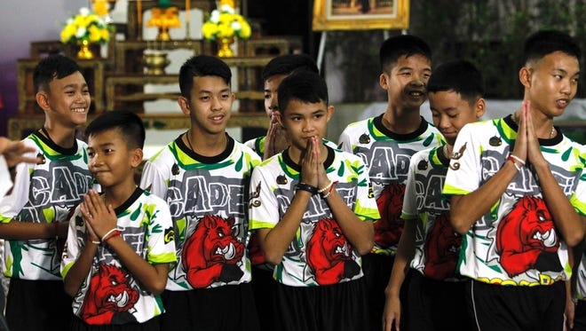 Some of the 12 members of the Wild Boar soccer team, who were rescued from the Tham Luang cave, greet the media  in Chiang Rai, Thailand, on July 18, 2018. The tightly controlled interview with the media was the first public appearance for the members of the team and an assistant coach, who were trapped in the Tham Luang cave for several days since they were rescued.