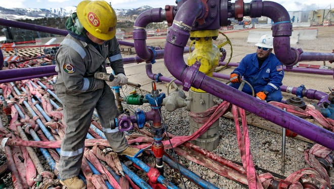 In this 2013 photo, workers tend to a well head during a hydraulic fracturing operation in western Colorado. Fracking is one of the issues addressed in the N.C. League of Conservation Voters' 2014 Legislative Scorecard.