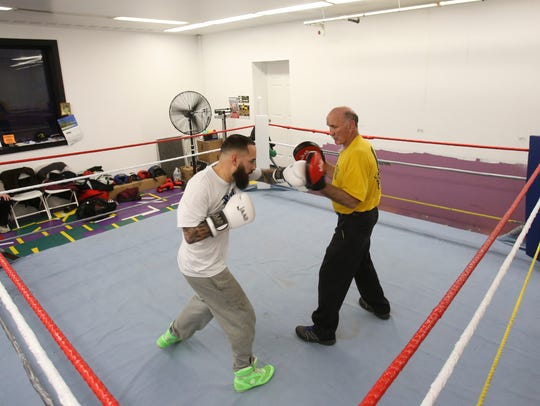 Joe Tiberi (right) works out his son, pro boxer Joey