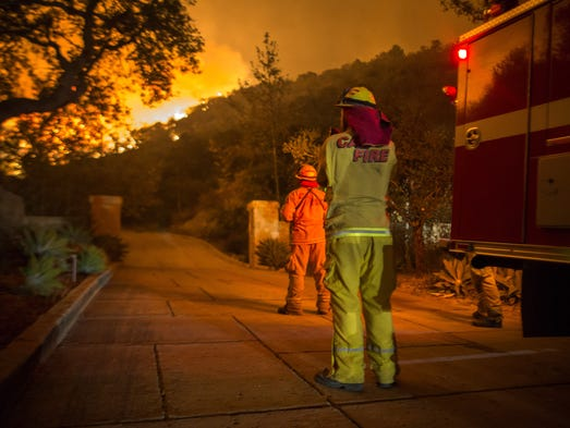 Firefighters watch flames as the Thomas Fire approaches