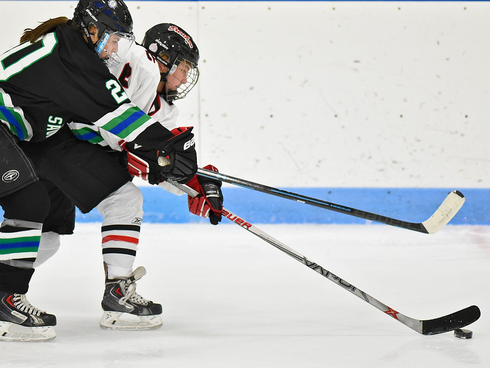 Brooke Walters of the Storm 'N Sabres tries to get the puck from Allie Cornelius of the Icebreakers during the first period of Thursday's game at the MAC in St. Cloud.