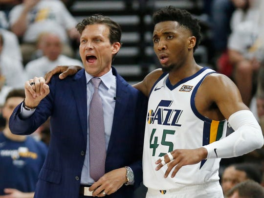 Utah Jazz head coach Quin Snyder and guard Donovan Mitchell (45) speak in the first half during Game 4 of a first-round NBA basketball playoff series against the Houston Rockets, Monday, April 22, 2019, in Salt Lake City. (AP Photo/Rick Bowmer)