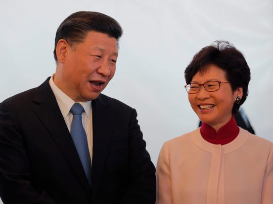 Chinese president Xi Jinping, left, shares a light