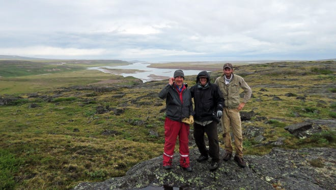 Gary Roemer, center, New Mexico State University associate professor, with wildlife biologist Myles Lamont, right, and helicopter pilot Frank Carmichael. They traveled with wildlife biologist Charles Britt to Coronation Gulf in Nunavut, Canada to sample and brand golden eagles.