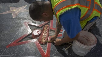 A construction worker rebuilds Donald Trump's destroyed star on the Hollywood Walk of Fame.